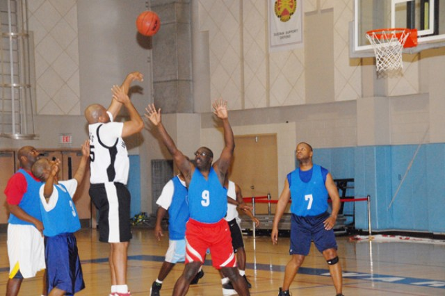 Staff Sgt. Jereld Jones shoots a ball during the Warrior Country Men's 33 and older basketball game, Jan. 15 at the USAG-Casey Carey Fitness Center. The Casey team won the game 46-45 and will move on to the 8th Army Championship.