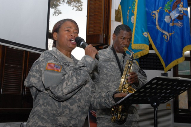 "(From left to right) Spc. Carla Rance sings the last notes of the song ""Lift Every Voice and Sing"" with the help of Sgt. Maj. Christopher Pritchard during an observance celebration honoring Dr. Martin Luther King Jr. Jan. 15 in the 2nd Infantry Division CG's Mess."