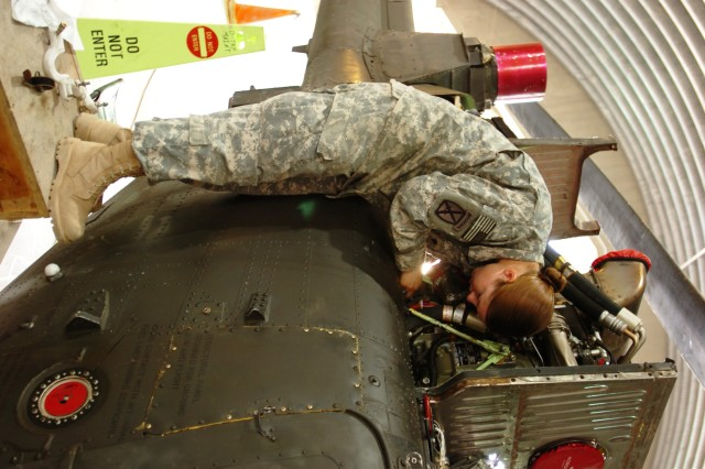 Specialist Sarah R. Ehlers, helicopter maintainer, Troop F, 1st Squadron, 230th Air Cavalry Squadron, from Gordon, Neb., in the Tennessee Army National Guard, conducts maintenance on an OH-58D Kiowa Warrior helicopter at Forward Operating Base Sykes, Tall Afar, Iraq, Nov. 8. (Photo by: Staff Sgt. Mike Alberts  25th Combat Aviation Brigade Public Affairs)
