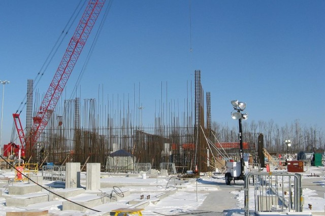 Ironworkers place reinforcing steel for walls in the blast containment area of the Munitions Demilitarization Building.