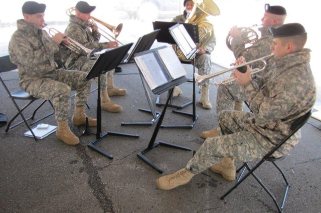 """The brass quintet, called """"All Brass... No Ammo,"""" is part of the Army Materiel Command Band. Performing at last week's groundbreaking are, clockwise from left, Spc. Mark-Daniel Mitchell from Philadelphia, Pa., on trumpet; Sgt. 1st Class Jeremy Davis, the music performance team leader from Palm Bay, Fla., on trombone; Staff Sgt. Stephen Edgerton from Durham, N.C., on tuba; Staff Sgt. Todd Swank from Phoenix, Ariz., on French horn; and Spc. Aaron Brizuela from Killeen, Texas, on trumpet."""