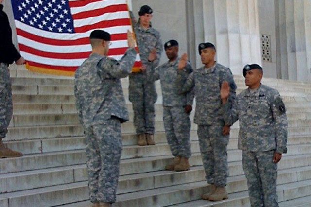 Maj. Michael Capps, commander of the 289th Military Police Company, administers the oath of enlistment to three of his Soldiers Dec. 18 on the steps of the Lincoln Memorial. The Soldiers reenlisting are, from left, Sgt. Chisholm, Staff Sgt. Braulio Fulp and Staff Sgt. Baron Fulp.