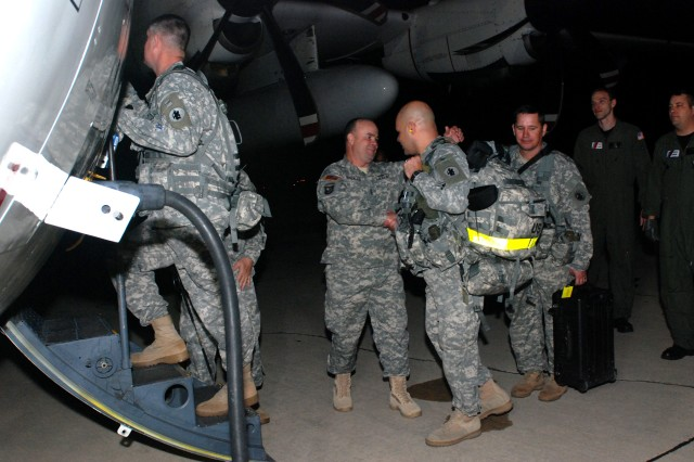Command Sgt. Maj. Luis Gonzalez (center) bids farewell to Lt. Col. Jose R. Delgado at Kelly Field in San Antonio, Texas, Jan. 23. In an ongoing effort to aid earthquake victims in Haiti, additional U.S. Army South Soldiers and civilians deployed as part of Joint Task Force Haiti and Operation Unified Response.
