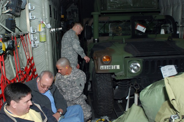 U.S. Army South Soldiers and civilians prepare to travel on a C-130 military airplane at Kelly Field in San Antonio, Texas, Jan. 23. In an ongoing effort to aid earthquake victims in Haiti, additional U.S. Army South Soldiers and civilians deployed as part of Joint Task Force Haiti and Operation Unified Response.
