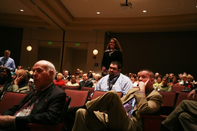 Karen Butler, G1, reads audience questions during the U.S. Army Space and Missile Defense Command/Army Forces Strategic Command Town Hall that took place on Jan. 21 at the Bob Jones auditorium.