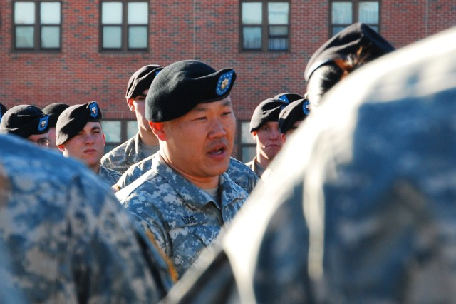 Lt. Col. Michael Loos, commander of 2nd Battalion, 22nd Infantry Regiment, talks with Soldiers during the battalion's casing of the colors ceremony Jan. 21 on Fort Drum.