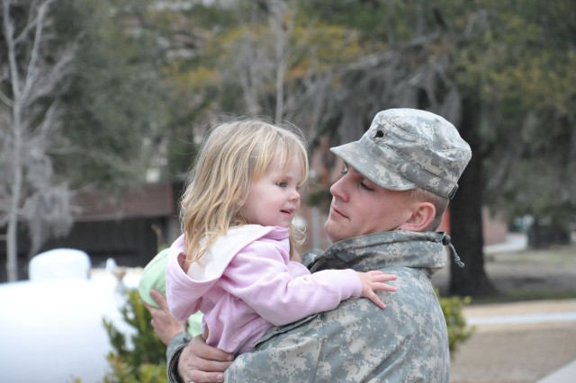 Specialist Laston Lowry, 10th Transportation Company, 3rd Sustainment Brigade, 3rd Infantry Division says goodbye to his daughter, Jessie, as he prepares to depart for Haiti with more than 150 of his fellow Soldiers of the 10th Trans. Co., in support of Operation Unified Response, Jan. 23. The unit will join military members across all five services in providing humanitarian relief efforts to the survivors of the earthquake-ravaged nation.
