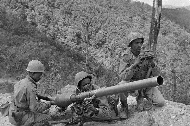 Ethiopia was the first nation in Africa to contribute a complete unit of ground troops to the UN Korean command.  Three Ethiopian gunners from Addis Ababa preparing to fire a 75mm recoilless rifle are, from left to right:  Cpl. Alema Welde, Cpl. Chanllo Bala and Sgt. Maj. Bogale Weldeynse.
