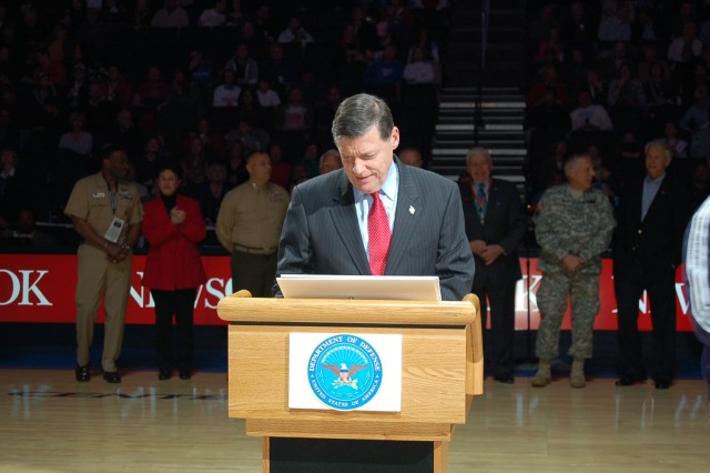 Congressman Tom Cole, 4th Congressional District, is the first to sign during the formal Community Covenant ceremony at halftime.