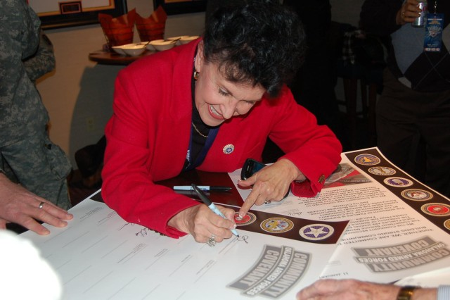 Dr. Sharon Lease, Asst. State Superintendent of Oklahoma Education, happily signs her name to the Community Covenant document.