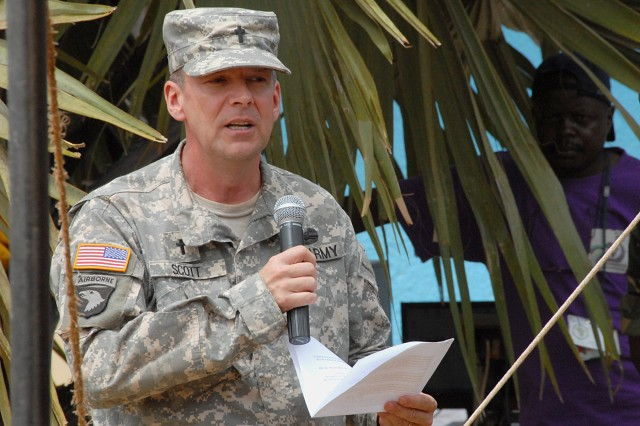 Maj. Clyde Scott, a U.S. Army Africa chaplain, honored Capt. Benjamin Sklaver during an Oct. 23, 2009 ceremony in Kitgum, Uganda. Sklaver, who was killed Oct. 2, 2009 in Afghanistan, previously served in northern Uganda.