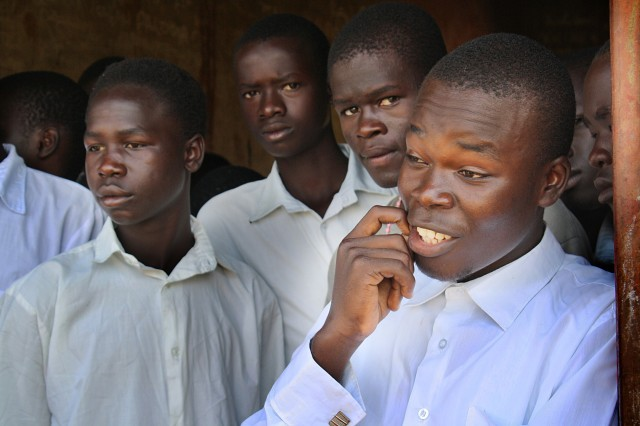 Staff Sgt. John Okumu mentors youth during Natural Fire 10, a humanitarian exercise in Uganda.