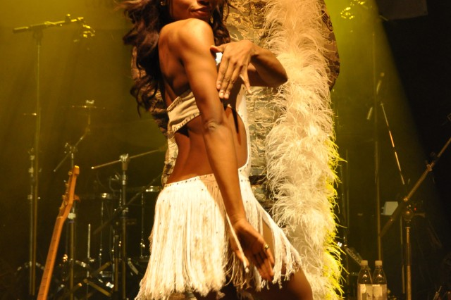 Dallas Cowboys Cheerleader Nicole Hamilton taunts Senior Airman Matthew Heckmann with a seductive dance routine during the USO concert. The Dallas Cowboys Cheerleaders joined Neal McCoy and his band on a tour across Europe.