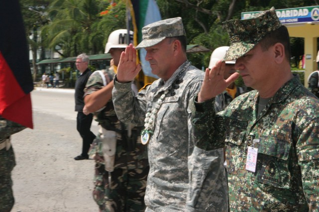 ZAMBOANGA, Philippines (Jan. 27, 2010) U.S. Army Lt. Gen. Benjamin Mixon, commanding general of U.S. Army Pacific and Armed Forces of the Philippines Lt. Gen. Benjamin Dolorfino, commander Western Mindanao Command, are rendered honors during a visit to the WESTMINCOM headquarters. Mixon was in the Philippines for three days, visiting with AFP counterparts, U.S. Embassy representatives and about 20 Soldiers from Joint Special Operations Task Force-Philippines who are originally assigned to USARPAC. Service members here are temporarily deployed to the Philippines, supporting the AFP countering terrorism and assisting with humanitarian and construction projects. (U.S. Marine Corps photo by Sgt. Jose Castellon/Released)