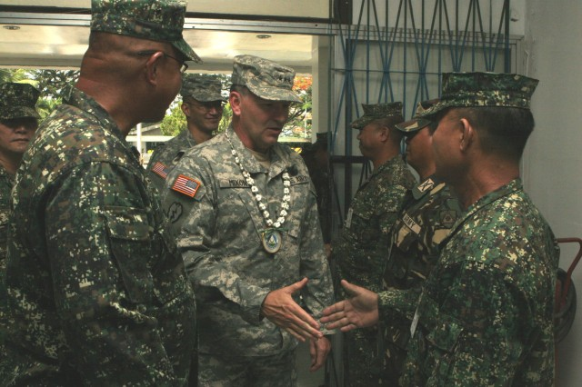 ZAMBOANGA, Philippines (Jan. 27, 2010) U.S. Army Lt. Gen. Benjamin Mixon, commanding general U.S. Army Pacific, greets staff members from the Armed Forces of the Philippines Western Mindanao Command. Mixon was on a three-day visit to the Philippines, meeting with AFP officials, U.S. Embassy representatives and about 20 Soldiers assigned to Joint Special Operations Task Force-Philippines from USARPAC. Service members here are temporarily deployed to the Philippines, supporting the AFP countering terrorism and assisting with humanitarian and construction projects. (U.S. Marine Corps photo by Sgt. Jose Castellon/Released)