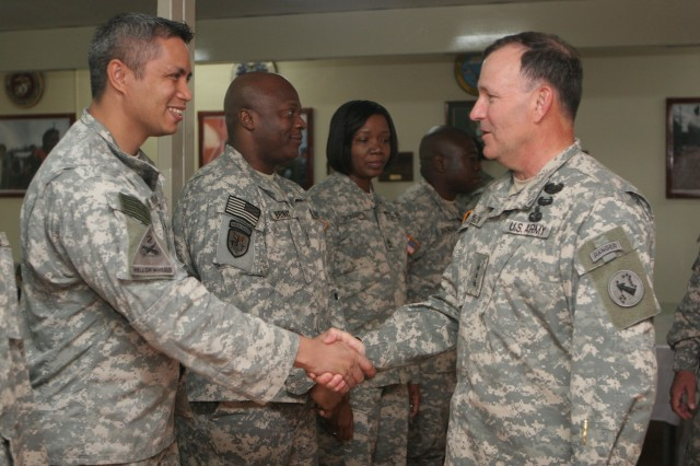 ZAMBOANGA, Philippines (Jan. 27, 2010) U.S. Army Chief Warrant Officer 3 Henry Perreira, assigned to Joint Special Operations Task Force-Philippines, shakes hands with Lt. Gen. Benjamin Mixon, commanding general of U.S. Army Pacific. Mixon was in the Philippines on a three-day command trip, visiting with Armed Forces of the Philippines counterparts, U.S. Embassy officials, and about 20 Soldiers assigned to JSOTF-P, originally from USARPAC. Service members assigned to JSOTF-P are temporarily deployed to the Philippines, supporting the AFP countering terrorism and assisting with humanitarian and construction projects. (U.S. Marine Corps photo by Sgt. Jose Castellon/Released)