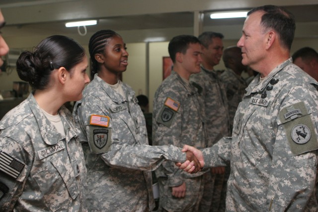 ZAMBOANGA, Philippines (Jan. 27, 2010) Lt. Gen. Benjamin Mixon, commanding general of U.S. Army Pacific, greets Spc. Jennie Scipio, a supply clerk at Joint Special Operations Task Force-Philippines. Mixon was in the Philippines on a three-day command trip, visiting with nearly 20 Soldiers from USARPAC, U.S. Embassy officials and Armed Forces of the Philippines counterparts. Service members deployed here are temporarily assigned to the Philippines, supporting the AFP countering terrorism and assisting with humanitarian and construction projects. (U.S. Marine Corps photo by Sgt. Jose Castellon/Released)