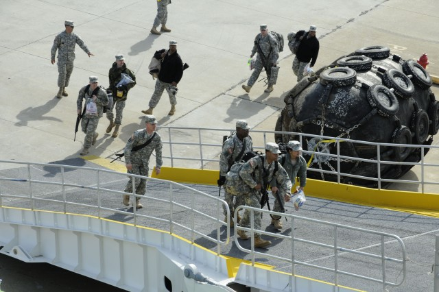 FORT EUSTIS, Va. - Soldiers assigned to the 7th Sustainment Brigade, 49th Quartermaster Group and the Surface Deployment and Distribution Command, board the High-speed ferry the MV Huakai at Fort Eustis' 3rd Port as they prepare to depart for Haiti in support of Operation Unified Response. (U.S. Army photo by Sgt R. J. Gilbert)