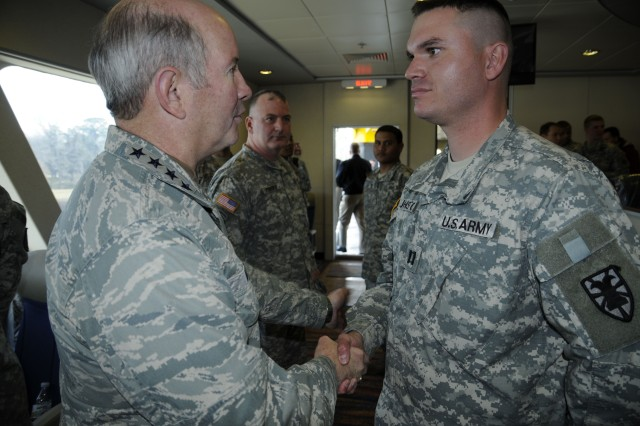 FORT EUSTIS, Va. - General Duncan J. McNabb, commander, United States Transportation Command, presents a coin to Capt. James Johnston, commander, 119th Inland Cargo Transfer Company, 11th Transportation Battalion, 7th Sustainment Brigade on board the High-speed ferry the MV Huakai, Jan. 27 at Fort Eustis' 3rd Port. (U.S. Army photo by Sgt R. J. Gilbert)