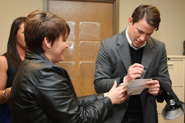 "Channing Tatum, right, autographs Cathy Lamberty's ticket before attending the special Fort Bragg premier of his new movie, ""Dear John,"" at York Theater, Saturday. Lamberty is married to Sgt. 1st Class Jose Lamberty from the Special Operations Recruiting Battalion."