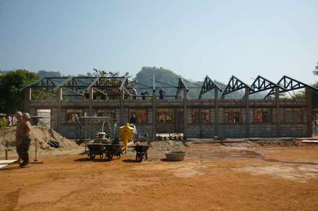 Royal Thai Soldiers and U.S. forces work to build a multi-purpose building at the Bann Radar School in Kanchanaburi, Thailand.