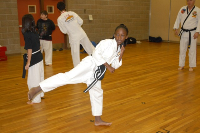 Briana Grant practices kicks and form during tae kwon do class.  The Korean martial art involves using hands and feet.  Certified instructor Bob Ford of the International Tae Kwon Do Alliance said those skills are easily acquired by young students.  SKIESUnlimited  offers beginner, intermediate and advanced classes for ages 5 to 18.