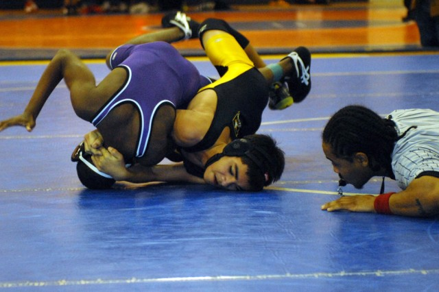 Fort Benning's Brandin Maier locks up Jalan Andrews, of Upson-Lee County Middle School, in his second match Saturday in the Chattahoochee Valley Middle School Championships at East Columbus Magnet Academy.  Maier captured a gold medal in the 102-pound weight class.
