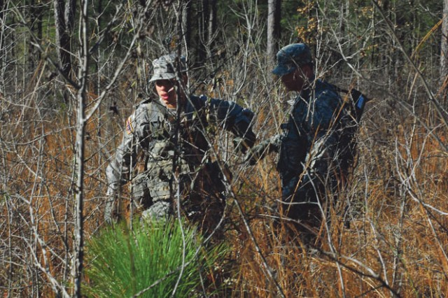 """Soldiers with 1st Platoon maneuver through the trees while trying to keep on track."""""""