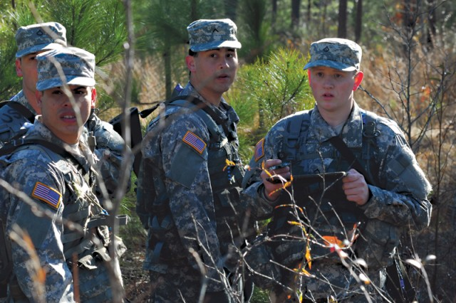 """PFC James Henry serves as """"point-man"""" for his squad as it attempts to find all five points in its section of the land navigation course Tuesday on Sand Hill. The Soldiers are in their third week of basic training with 1st Platoon, B Company, 3rd Battalion, 47th Infantry Regiment, 192nd Infantry Brigade."""""""