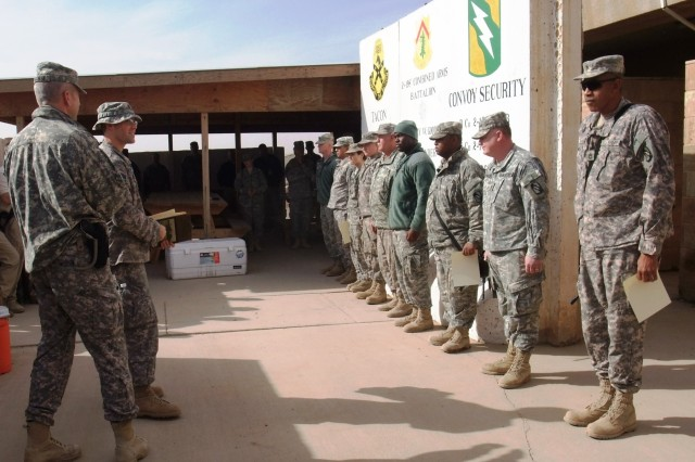 CONTINGENCY OPERATING LOCATION Q-WEST, Iraq - Lt. Col. Kerry Goodman (foreground), a Meridian, Miss., resident and commander of 2nd Battalion, 198th Combined Arms, out of Senatobia, Miss., and Capt. Robert P. Sayle, battalion safety officer and native of Lake Cormorant, Miss., address company fire wardens during a recognition ceremony here Jan. 20. The unit had no major accidents or injuries up to this point of its deployment, largely as a result of these safety representatives, said Goodman.