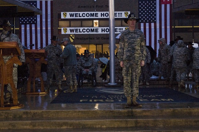 Maj. Gen. Dan Bolger, commanding general, 1st Cavalry Division, stands in waiting to welcome home the Ironhorse Brigade after they make their soggy trek across Fort Hood's Cooper Field Jan 29. About 270 1st Brigade Combat Team, 1st Cav. Div., Soldiers returned from a year-long tour in Iraq. During the welcome home ceremony the leadership of the Ironhorse brigade and its battalions uncased their colors signifying the unit's return.