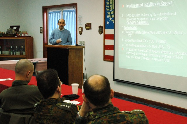Dr. Jeton Muhaxihiri of the Food and Agriculture Organization of the United Nations gives a presentation on Avian Influenza at the Veterinary Grand Rounds event held at Camp Bondsteel, Kosovo, Jan. 28.