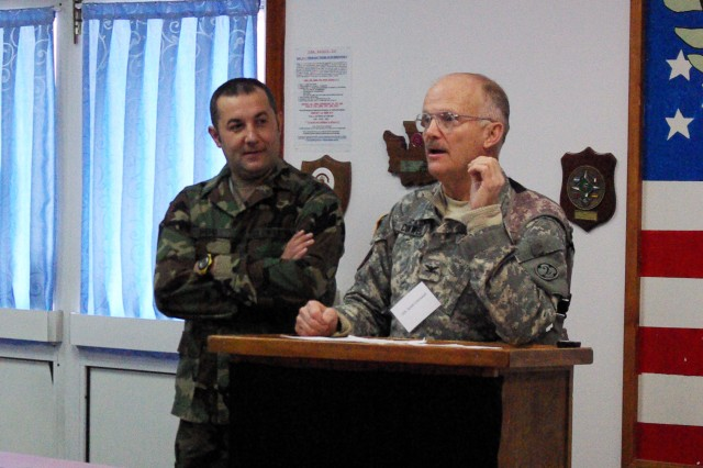 Col. Scott Cornwell gives a welcome address to attendees at the Veterinary Grand Rounds event held at Camp Bondsteel, Kosovo, Jan. 28.