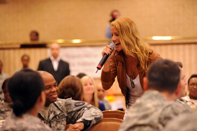 Recording artist Leigh Jones performs for a Warrior Transition Unit and Better Opportunities for Single Soldiers group at Fort Belvoir Community Club on May 6, 2009. Jones will headline the I. A.M. Strong musical/comedy tour headed to 24 installations to help raise awareness about the prevention of sexual assault and harassment.