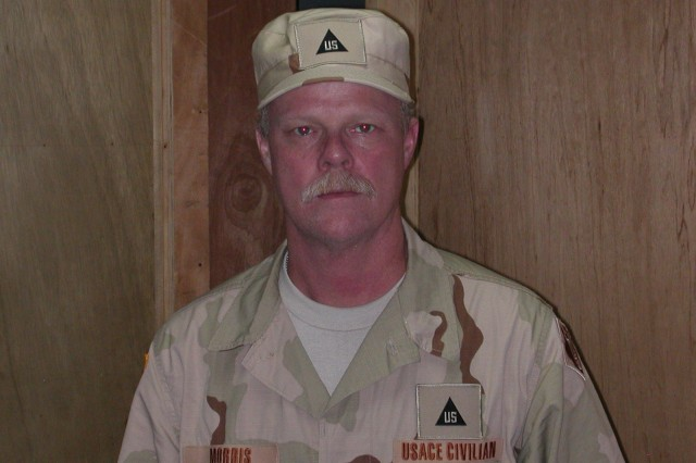 Jeff Morris, Fort Carson civilian, in uniforms as he is deployed to Iraq. Morris signed up to deploy to lend his expertise as an electrician to help save Soldiers' lives.