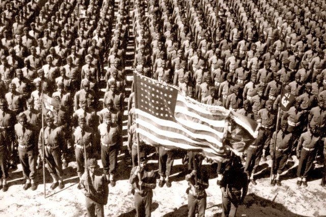 A formation of African-American troops stand at attention prior to World War II.