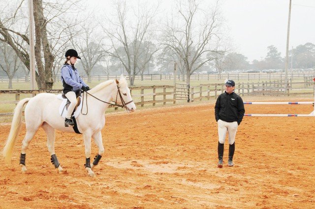 FORT RUCKER, Ala. - Two-time Olympic Gold Medalist and International Eventer Phillip Dutton watches Alex Sebren, 11, and Savannah, a 10-year-old Quarter Horse Appaloosa Paint cross, perform dressage movements during a clinic Saturday at the Riding Stables for area Pony Club members.