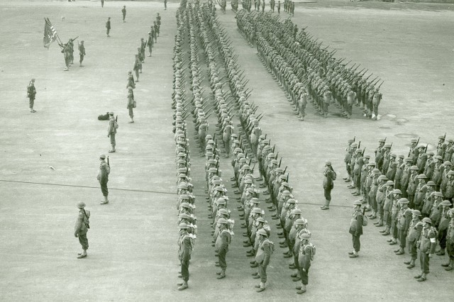 On Parade! This image shows 34th Infantry Division personnel formed up on the parade ground being reviewed by their Commanding General, Major General Russell P. Hartle. (WW2 Signal Corps Photograph Collection).