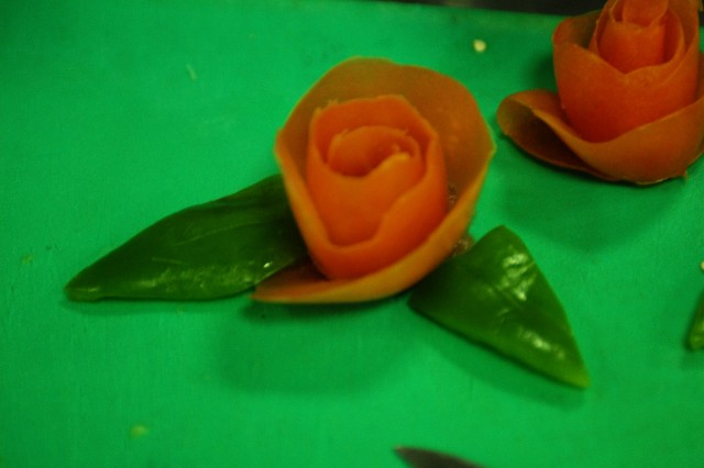 A rose made of green bell peppers and a tomato is seen on the table of the Raider Inn Dining Facility team Jan. 30, at the Iron Chef competition at Camp Victory in Baghdad. The competition was a way for Soldiers to express their creativity while enhancing their cooking skills.