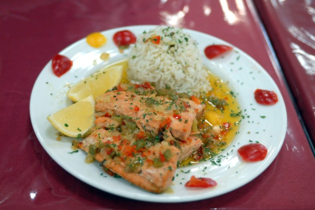 A plate of salmon and rice waits to be tasted and judged during the Iron Chef competition Jan. 30, at Camp Victory in Baghdad, Iraq. First Sgt. Donald Robertson, Headquarters Support Company, I Corps first sergeant, said the salmon was his favorite dish.