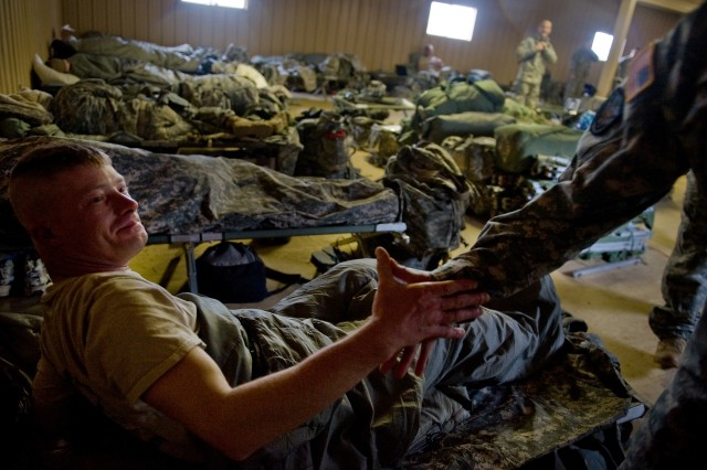 A Soldier wakes up and shakes hands with Gen. George W. Casey Jr., Chief of Staff of the Army, Ft. Polk, LA, Jan. 29, 2010.  Fort Polk serves primarily as a training post for units preparing to deploy to war.