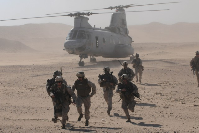 Marines from the 11th Marine Expeditionary Unit leave a CH-47 Sea Knight as they prepare to engage a command and control cell at Udari Range, Kuwait, as part of their final exercise, Jan. 23.  From the moment the helicopters landed, the Marines hit the ground running, clearing the command and control cell and leaving the area in under an hour. Udari range provides a unique opportunity for many units training in Third Army's area of responsibility, allowing battalion sized live-fire scenarios for all warfighters to train with the maximum amount of realism in a controlled and safe environment.
