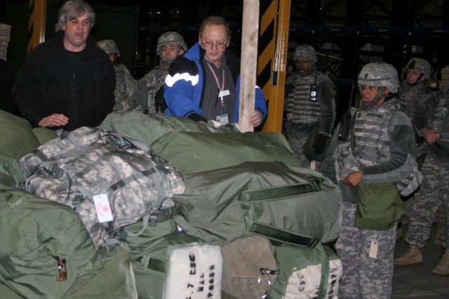Deployment Processing Center staff and 7th Civil Support Command Soldiers load duffle bags on to pallets for a mock deployment at the Deployment Processing Center Jan. 26. The Soldiers were part of the 7th CSC's Incident Management Team, a force of first responders to a natural or man-made disaster.