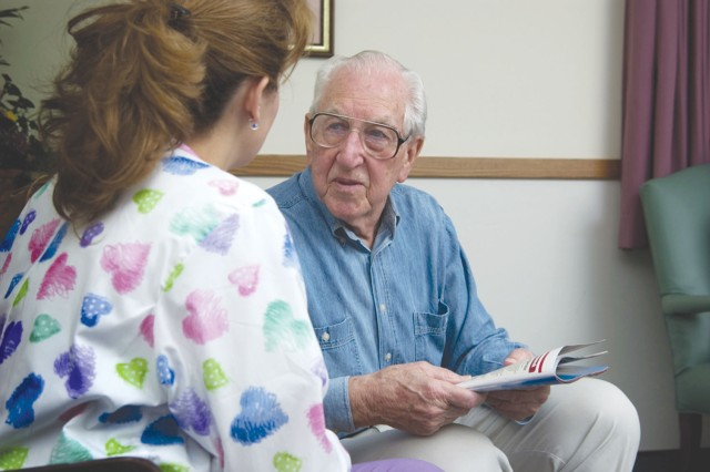 A nurse speaks to a patient about his medical history. Changes at DeWitt Army Community Hospital are intended to build more doctor/patient relationships to improve continuity and increase access to health care.