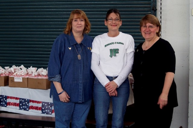 GREENSBURG, Pa. - Laura Yuhaniak, from the Soldier\'s Angels, Joy Palmer, of Jemajo Farms, and Dorothy Benyacko-Carbisiero, unit administrator and Family Readiness Group leader at the 14th Quartermaster Company here, stand together after distributing a donation to military families recently. Palmer, owner of Jemajo Farms, donated the equivalent of a quarter of beef to the families, already cut, wrapped, and freezer-ready. This is the second year that Jemajo Farms has donated meat to the families, a donation that helps to feed stomachs and save pennies while loved ones are deployed overseas.