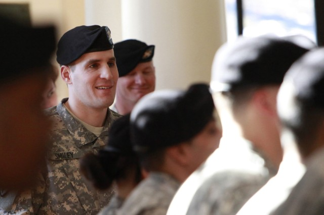 Captain Scott M. Smiley speaks briefly as cadre stands in formation after he  accepted command during the U.S. Army Warrior Transition Unit at West Point change of command ceremony Feb 1. Smiley is the first blind officer and second Wounded Warrior to hold a position of command in the Army.