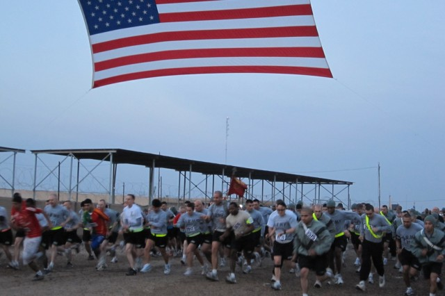 Service members and civilians, including local Iraqis, run in the Dr. Martin Luther King Jr. 5k run here Jan. 18.