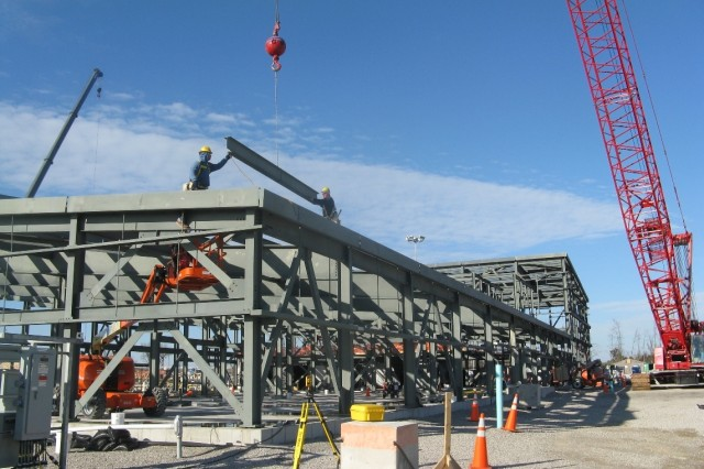 Ironworkers install the final structural steel beam for the Control and Support Building at the Blue Grass Chemical Agent-Destruction Pilot Plant.