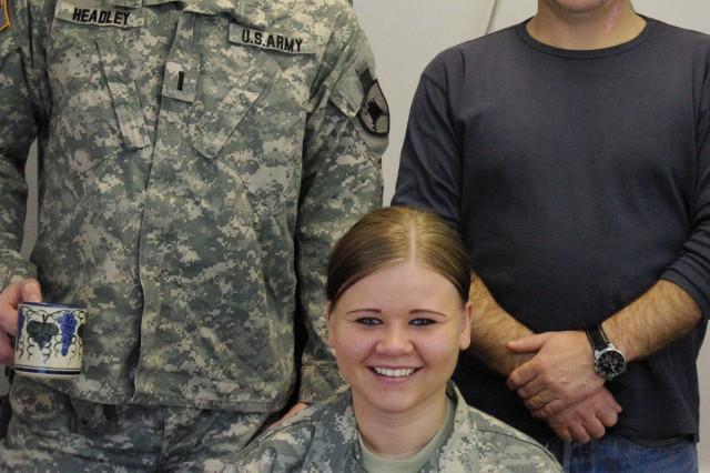 1st Lt. Matthew E. Headley, Grand Forks, N.D., Spc. Chelsey M. Brenna, Mayville, N.D., and civilian employee Sasha Sokolovski staff the legal services office at Camp Bondsteel, Kosovo.