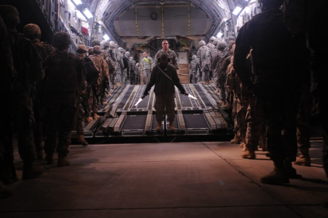 Redeploying Soldiers with the 1st Heavy Brigade Combat Team, 1st Cavalry Division, file onto a C-17 Globemaster III Jan. 26 at Camp Taji, Iraq. More than 3,000 Soldiers left Camp Taji in a 16-day period, marking the first fixed-wing redeployment operation from Camp Taji.